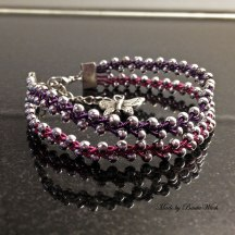 Flätat armband i tenntråd o silverpärlor